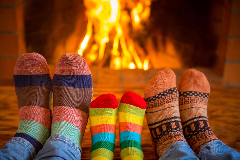 Family near fireplace